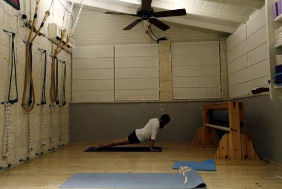 An ultra-Orthodox Jewish man does yoga on his mat before the start of a class in Ramat Beit Shemesh
