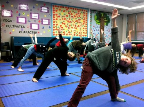 Third graders at Olivenhain Pioneer Elementary School do the Triangle pose during one of their bi-weekly yoga classes, Dec. 18, 2012. (photo: Kyla Calvert)