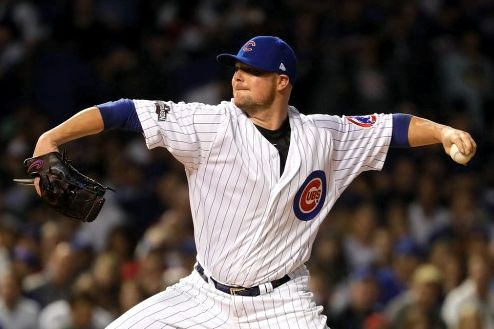 Jon Lester #34 of the Chicago Cubs not demonstrating a yoga pose, but we can pretend. | photo credit: Jamie Squire/Getty Images