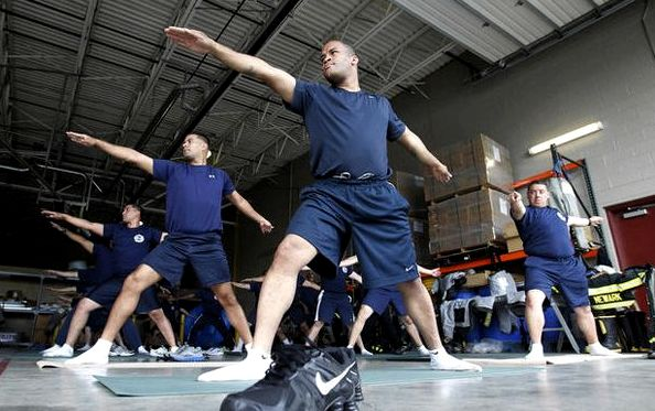 Newark firefighters train with yoga.