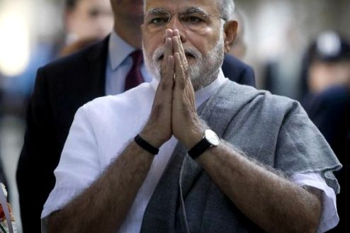 India's Prime Minister Narendra Modi gestures after laying a commemorative wreath at the site of the 9/11 Memorial in the lower Manhattan borough of New York September 27, 2014. Photo credit: Reuters/Carlo Allegri