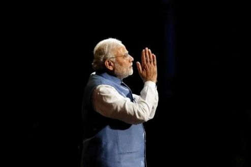 Modi reacts as he speaks to members of the Australian-Indian community during a reception at the Allphones Arena located at Sydney Olympic Park in western Sydney