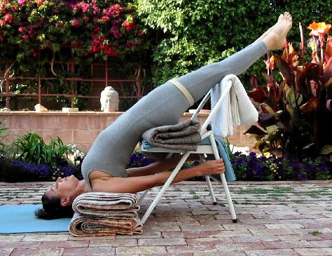 yoga shoulderstand with blankets supported